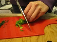 Finely chopping the parsley