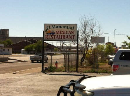 Mexican restaurant sign in industrial looking area