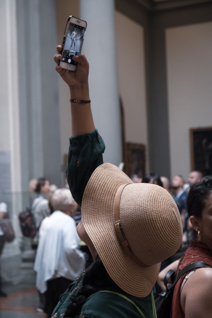 Woman taking picture of Michelangelo's David