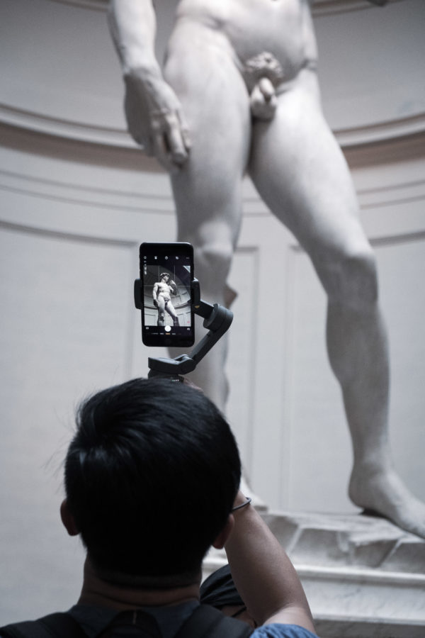Man taking pictures of Michelangelo's David