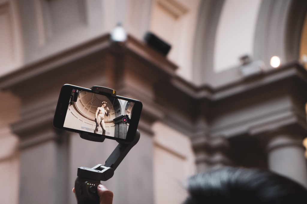 Visitors taking video of the David of Michelangelo