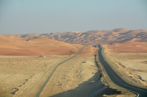 Heading down the blacktop after Qasr Al Sarab into the wild...