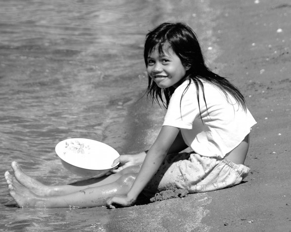 This gorgeous girl spent her morning before the school bus came, trawling for brine prawns..we watched her and her sister every morning back and forth with a wooden structure in the sea to catch minuscule prawns for drying and selling, shot taken just after sunrise..they had been out there since 4am....