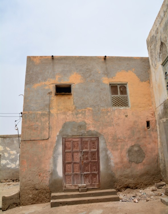 Spotted, my first door! Just round the corner from the sea-front a little square surrounded by crumbling houses and Omani doors and windows....
