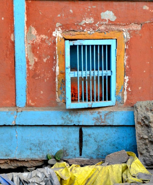 This blue window is a street level, seems to be rocks inside.I'm still wondering why it's there...