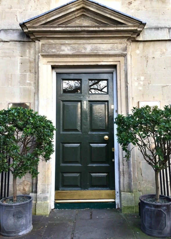 Door, architrave and carefully aligned trees, very elegant...