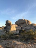 Steve climbing the rock pile