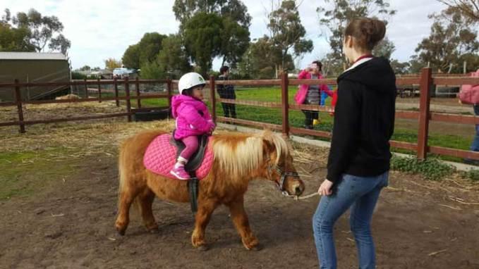 kid riding horse