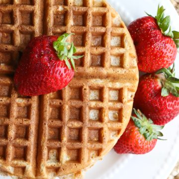 cooked waffle with strawberries