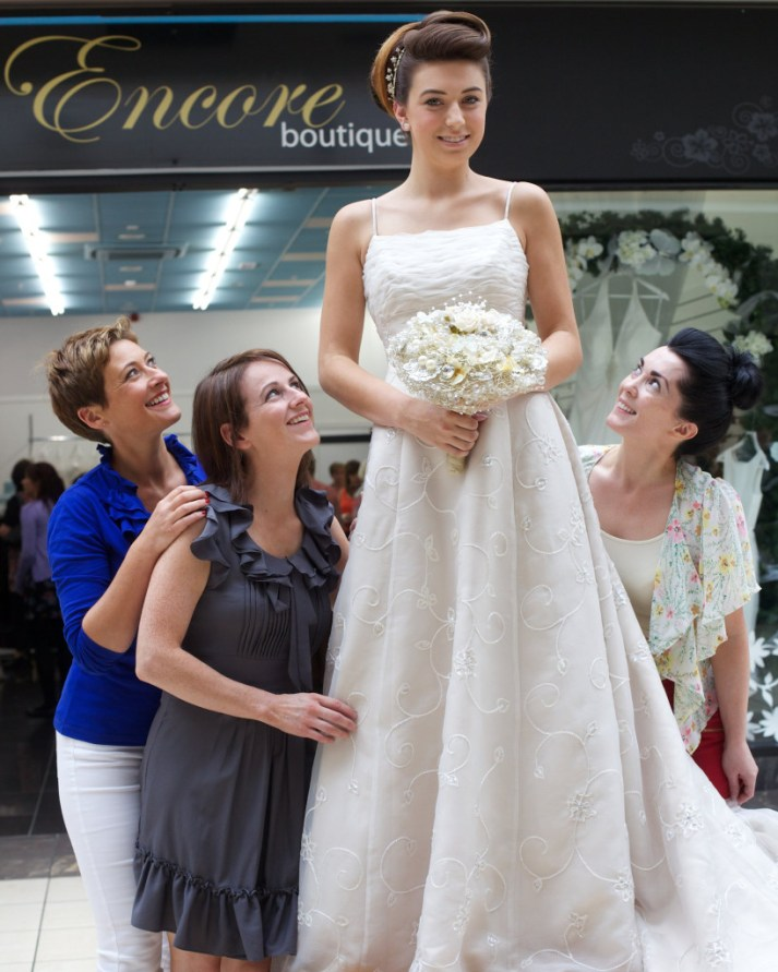 BBC newsreader Jo Scott was on hand this week to help launch 'Encore' pop up boutique in Buttercrane Shopping Centre. Jo is a patron of Southern Area Hospice Services, the charity which will benefit from the profits of Encore. Jo is pictured with models from Buttercrane Shopping Centre trying on the gowns. The models hair is by Gifted in Meigh and the shop interior design is by Creative Wedding Designs, Newry.