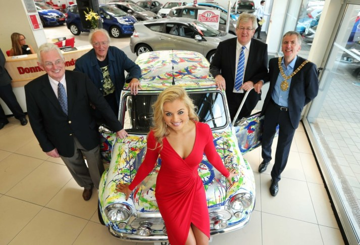 ONE OF A KIND ART MINI REVEALED IN DONNELLY SHOWROOM: An art MINI, painted by Northern Ireland artist Neil Shawcross (second from left) was unveiled in the Donnelly Group's Honda showroom on Belfast's Boucher Road by Chairman of the Paddy Hopkirk Golden Anniversary Gala Committee Dr. Beatty Crawford, former Miss Northern Ireland Tiffany Brien, Sales Director of the Donnelly Group Raymond Donnelly and the Lord Mayor of Belfast, Councillor Máirtín Ó Muilleoir. Photo Press Eye Kelvin Boyes