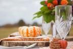 Urban Petals, table scape, outdoor wedding, reception, wood, rustic, pinecones, orange, purple, pumpkins, scabiosa pod, craspedia, billy balls