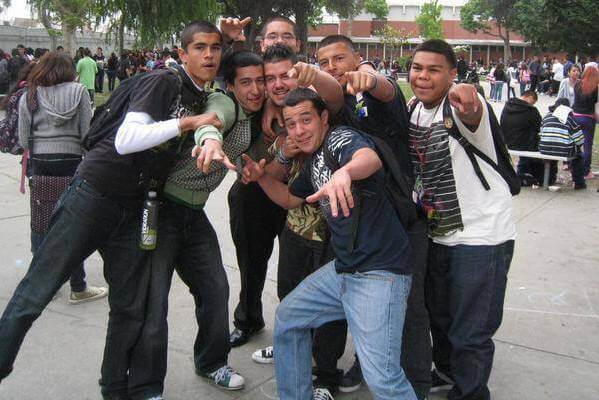 Jose with his friends at Fremont High School, 2009, photographed together, posing, and pointing at the camera.