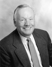 Black and white headshot photo of USC Alumni Neil Armstrong, who is looking into the camera and smiling.
