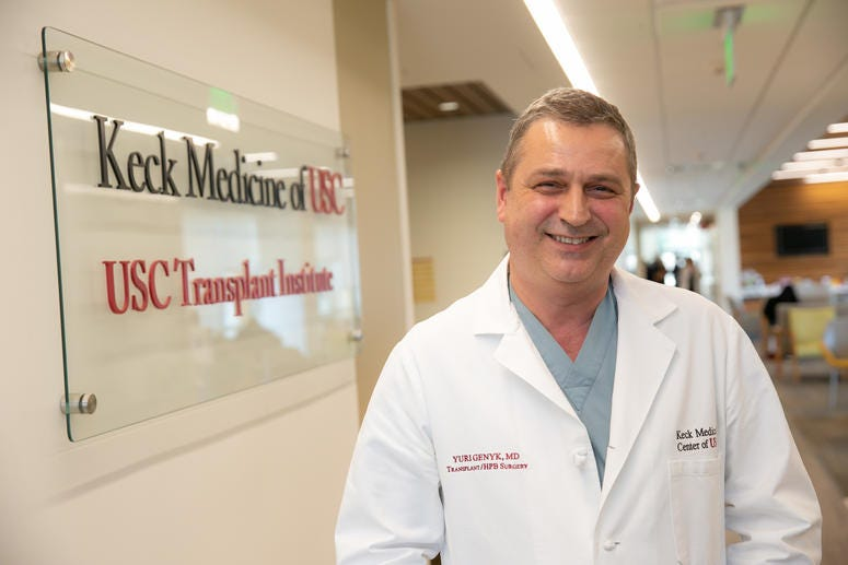 The life saving doctor Yuri Genyk, photographed in a medical lab coat and scrubs in the Keck Medicine of USC office.