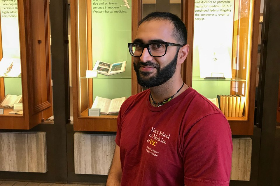 Medical Health student Anish Parekh is photographed inside a USC building entrance way.