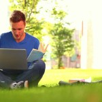 student studying outside in the grass