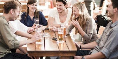 group of friends socializing at a bar