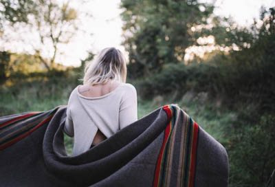 woman with blanket draped on shoulders