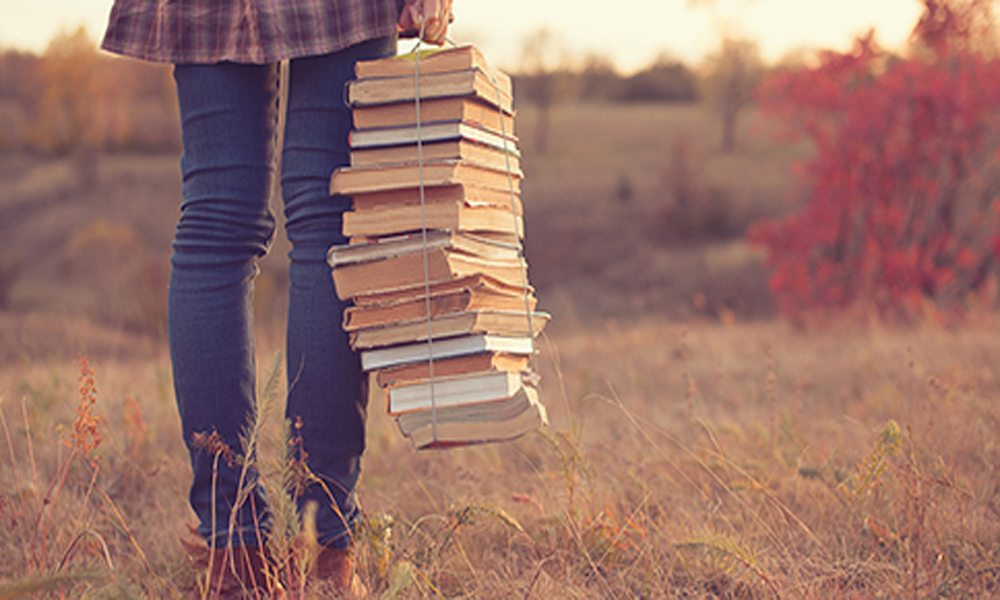 girl walking to class with her books