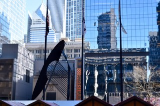 Hidden view of the untitled Chicago Picasso sculpture from behind a row of market stalls.