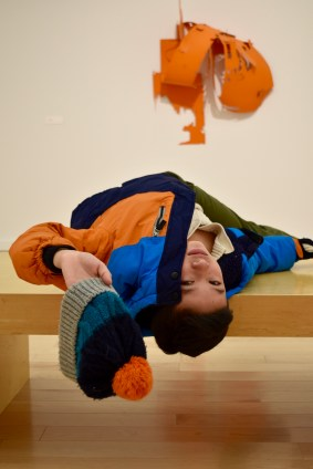 """My brother Timmy posing as """"art"""" in one of the exhibitions."""