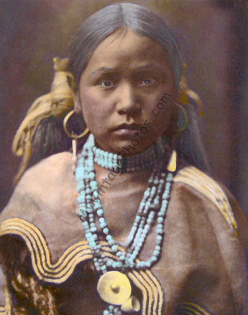 Hand color tinted photo of an Arapaho Jicarilla girl, Native American