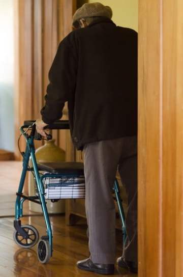 old man using the best folding rollator