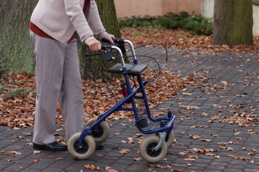 an elderly walking with a rollator