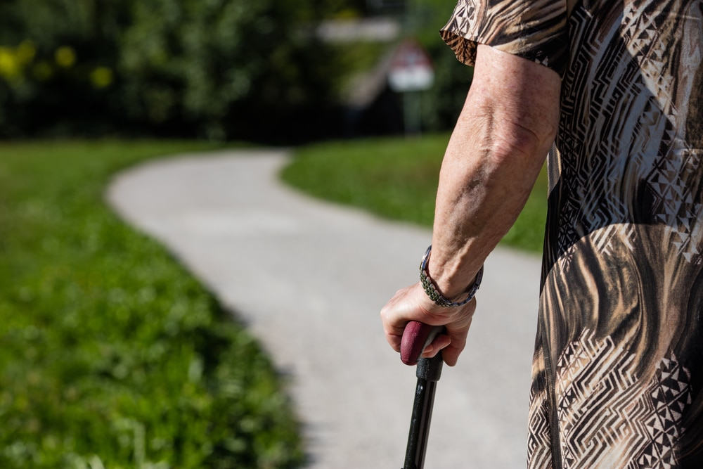 a senior using a walking cane