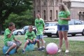 Rebecca Russell, organizer of the YAAYS program, explains to Cayden Wittrock (from left), Sean Ahler of and Ethan Hay, all of Elkhorn, how the group of campers will use the big colorful balls to represent the size of earth as they line them up to mimic the diameter of the sun in comparison.