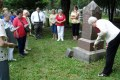 Pat Blackmer, of the Daughters of Union Veterans of the Civil War, places a Grand Army of the Republic marker on the grave of Civil War veteran John Brabazon.