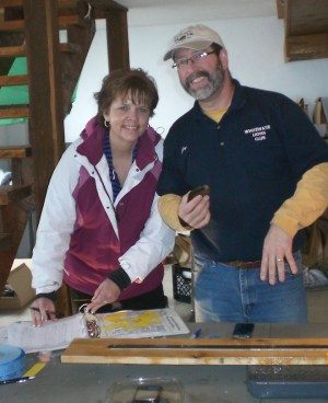 Fisherman Alex Plucinski (top) and his wife check out the fish board at last year's Fish-a-ree, hosted by the Whitewater Lions and Lioness clubs while Lion Joe Marino and his wife (above) man the weighing table. This year's event is set for 6 a.m. to 4 p.m., Sunday. (Submitted photo)