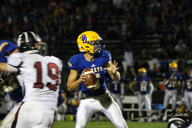 The Comets quarterback Jake Benzing completes a 41-yard pass to lead the Comets comeback against Badger on Friday. (Tanner Fields photo)