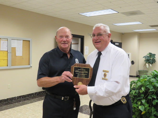 Delavan Police Chief Tim O'Neill (right) congratulates the Rev. Mike Ida on 11 years of voluntary service as the police department's chaplain. (Michael S. Hoey photo)
