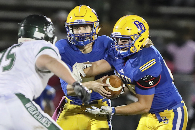 Jacob Benzing hands off to running back Ryan Gengler during last Friday's 41-6 home loss to Waterford. Delavan was held to 96 total yards.