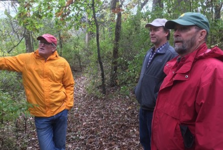 Geneva Lake Conservancy board members Kevin Brunner, Chris Todd and Mark Bromley visit Bromley Woods. The conservancy was recently named Land Trust of the Year by Gathering Waters: Wisconsin's Alliance for Land Trusts.