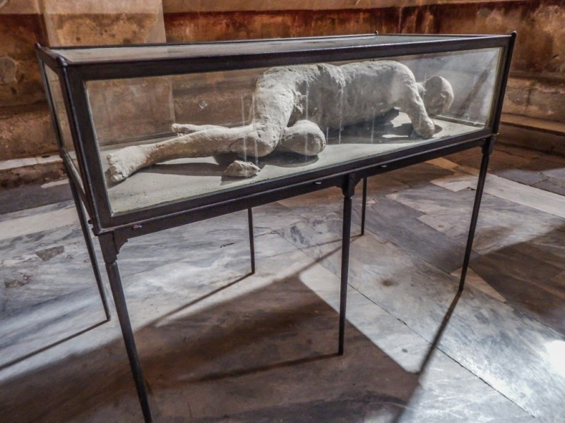 Ruins of pompeii and body cast in southern italy