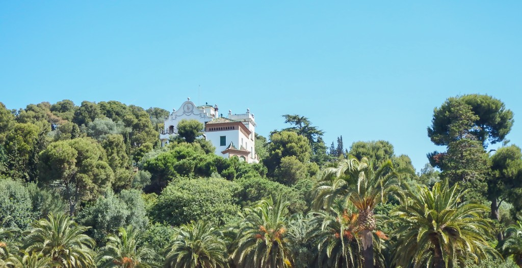 A house in the trees outside Antoni Gaudí's Park Güell in Barcelona, Spain