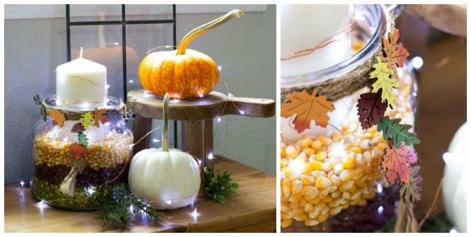 layered grain candle holder with pumpkins and fairy lights