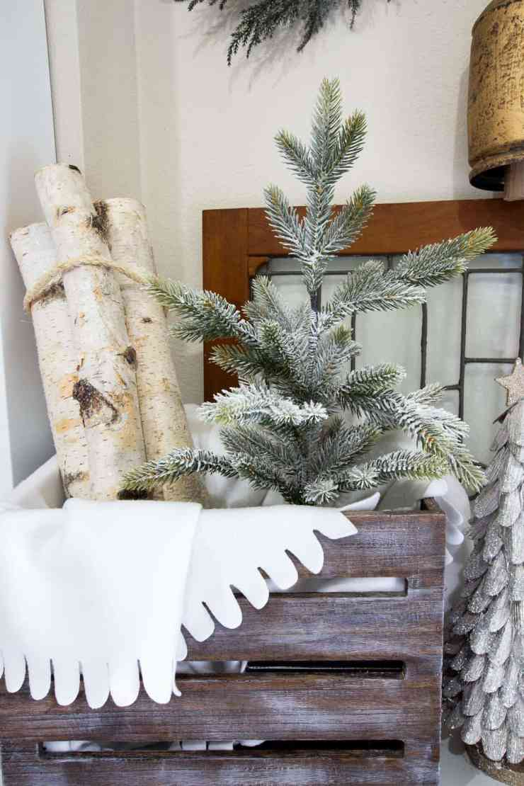 entryway christmas crate with tree and birch logs