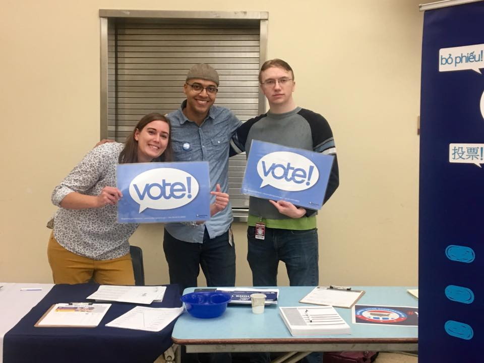 WHCA Board Vice President Devin Chicras and President Jeremy Williams with WA Bus Volunteer Garrett Davis at Renton High School, October 2019