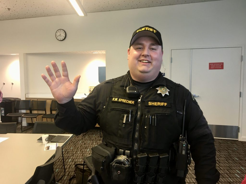 King County Sheriff's Office Deputy Ryan Sprecher, West Hill Community Crime Prevention Officer at February 15 2020 Coffee Hour at Skyway Library