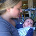 Sarah Beth holds the 6-week old baby
