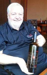 Harry McWatters with a bottle of his Time Estate Red Meritage