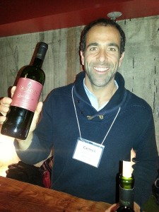 Wine maker Sebastian Labbe from Carmen holding a bottle of his Cabernet Sauvignon