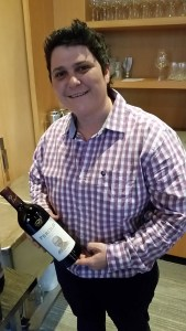 Izele van Blerk wine maker from KWV with a bottle of her Perold Tributum