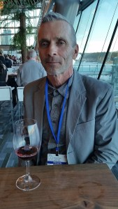 Randy Picton from Nk'Mip Cellars with a glass of his Pinot Noir