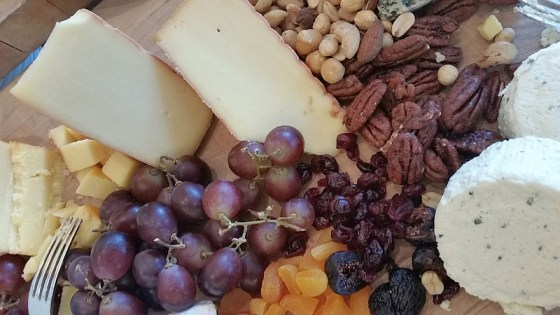 Cheese, grapes, and nuts to enjoy with a glass of wine