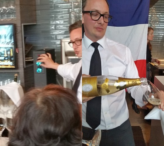 Joshua Carlson explaining their wine preservation system and then pouring a glass of Cristal champagne